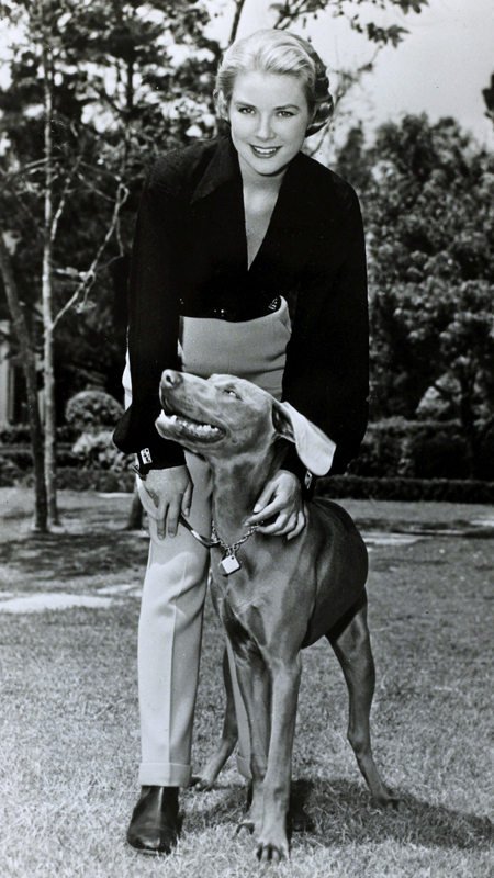 January 1956, American actress Grace Kelly, pictured with her dog