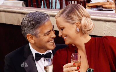 Amy Poehler's Recounts Sitting on Clooney's Lap in Book