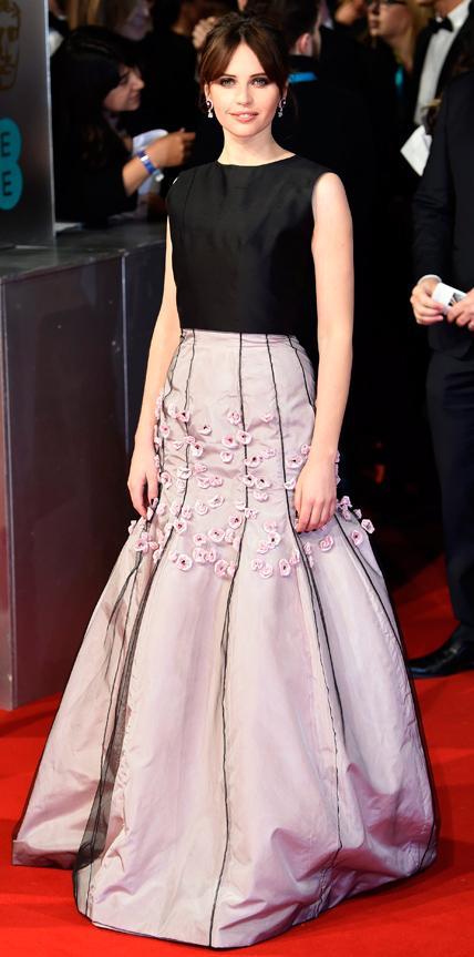 Felicity Jones in a black and lilac gown.