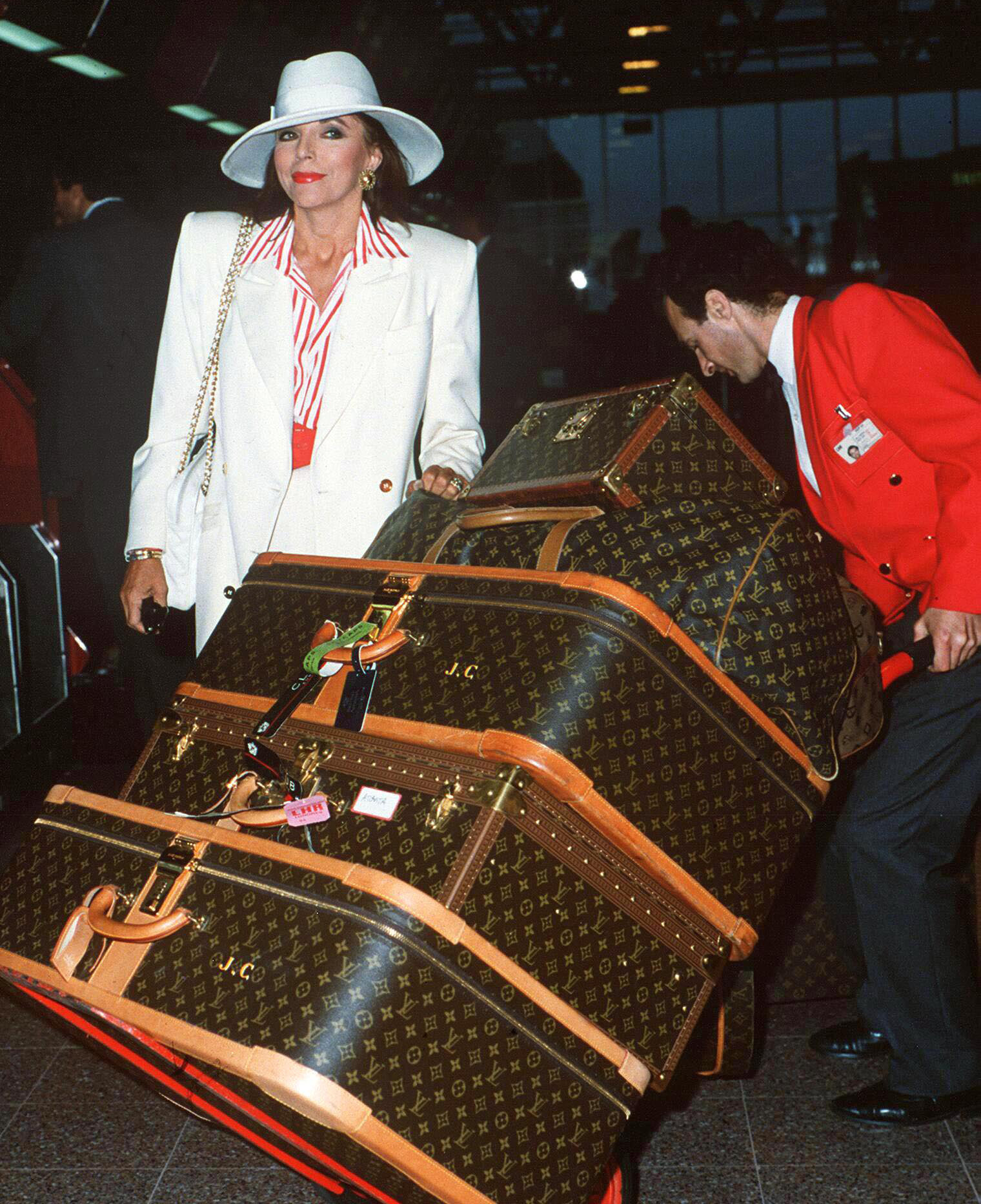 Joan Collins - luggage - 1989