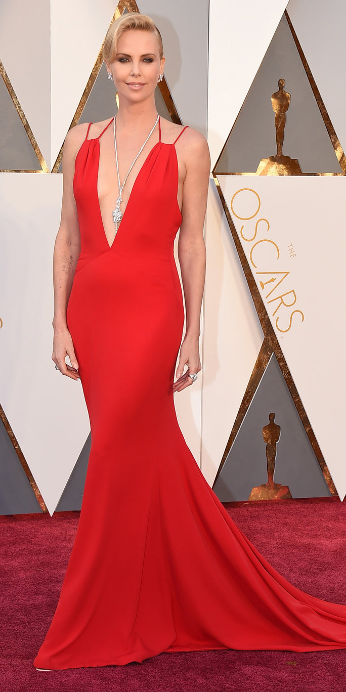 Charlize Theron arrives at the Oscars on Sunday, Feb. 28, 2016