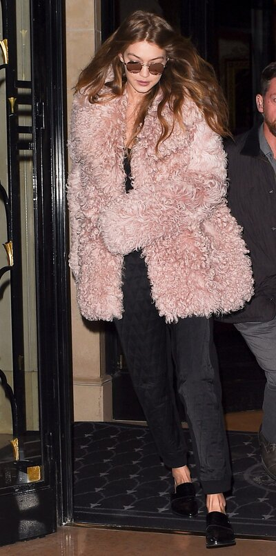 f3f9cf44b42 Gigi Hadid Channels Rihanna and Warms Up in a Fluffy Pink Coat at Paris  Fashion Week