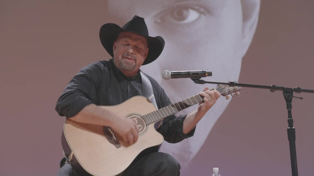 Garth Brooks and Dion Pride appear at NIAA award event in Nashville.