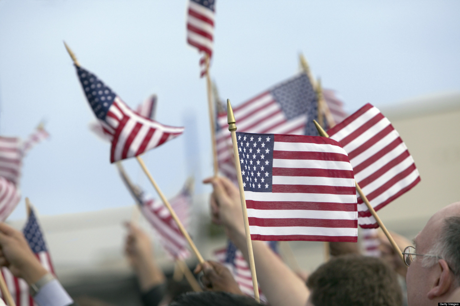Crowd Waving Stars and Stripes Flags