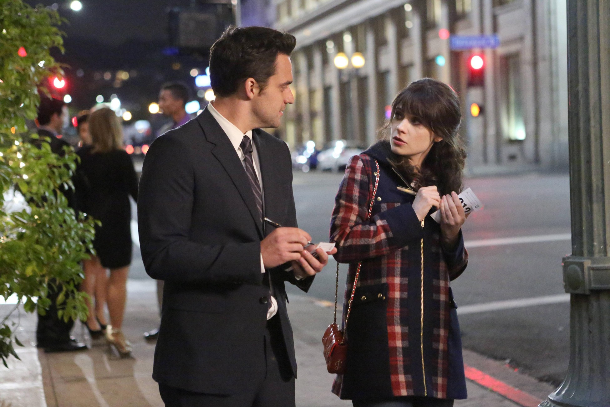"""NEW GIRL:  Jess (Zooey Deschanel, R) and Nick (Jake Johnson, L) try to define their relationship in the """"First Date"""" episode of NEW GIRL airing on a special night, Thursday, April 4 (9:00-9:30 PM ET/PT) on FOX.  ©2013 Fox Broadcasting Co.  Cr:  Adam Taylor/FOX"""