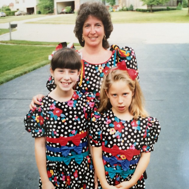I was obviously thrilled about wearing matching dresses. Just one reason why I was totally fine doing some things without my mom as a kid.