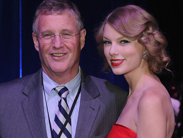 NASHVILLE, TN - NOVEMBER 29: ***EXCLUSIVE*** Scott Swift and Honoree/Daughter Taylor Swift at the 2011 CMT Artists of the year celebration at the Bridgestone Arena on November 29, 2011 in Nashville, Tennessee.  (Photo by Rick Diamond/Getty Images for CMT)