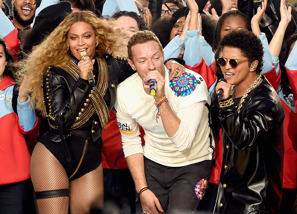 SANTA CLARA, CA - FEBRUARY 07:  (L-R) Beyonce, Chris Martin of Coldplay and Bruno Mars perform onstage during the Pepsi Super Bowl 50 Halftime Show at Levi's Stadium on February 7, 2016 in Santa Clara, California.  (Photo by Kevin Mazur/WireImage)