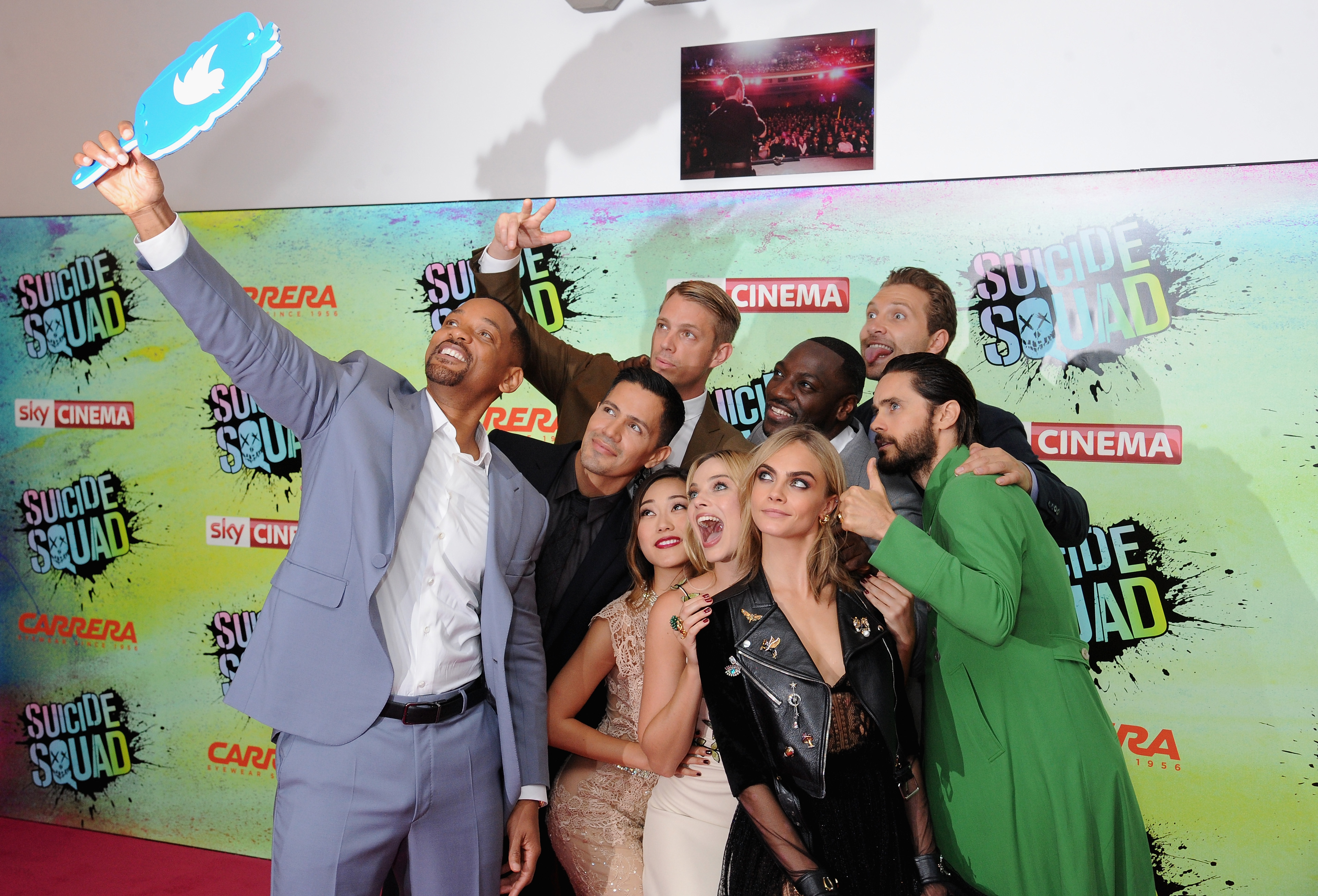 LONDON, ENGLAND - AUGUST 03:  (clockwise from L) Will Smith poses for a selfie with Jay Hernandez, Joel Kinnaman, Adewale Akinnuoye-Agbaje, Jai Courtney, Jared Leto, Cara Delevingne, Margot Robbie and Karen Fukuhara at the European Premiere of  Suicide Squad  at Odeon Leicester Square on August 3, 2016 in London, England.  (Photo by Dave J Hogan/Getty Images)