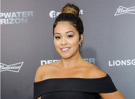 d94b36d065f We saw Gina Rodriguez wearing blush pink pants and a cool top