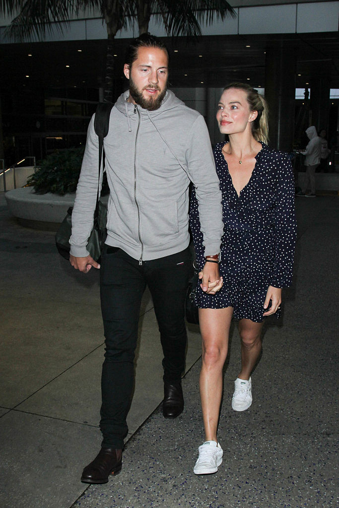 LOS ANGELES, CA - JANUARY 02: Margot Robbie and Tom Ackerley are seen at LAX on January 02, 2017 in Los Angeles, California.  (Photo by starzfly/Bauer-Griffin/GC Images)