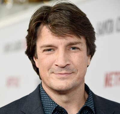 Nathan Fillion Appears To Be Trapped In A Disco Party Bus And His