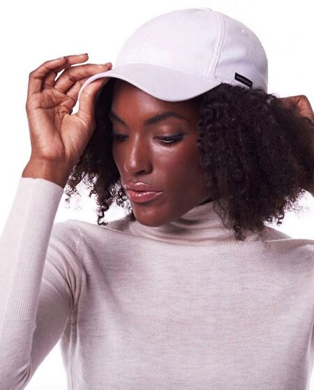 4fd23675fa4 This fashion brand creates satin-lined dad hats because it s actually great  for your hair