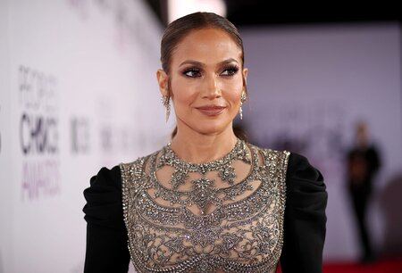 c91b2470b4b Jennifer Lopez drinks her coffee from a Starbucks cup covered in ...