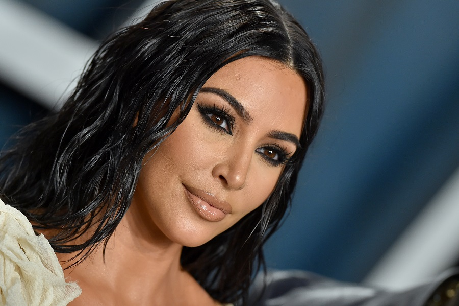 Kim Kardashian West has new sunshine blonde hair as part of a friendly competition with sisters Khloé and Kylie