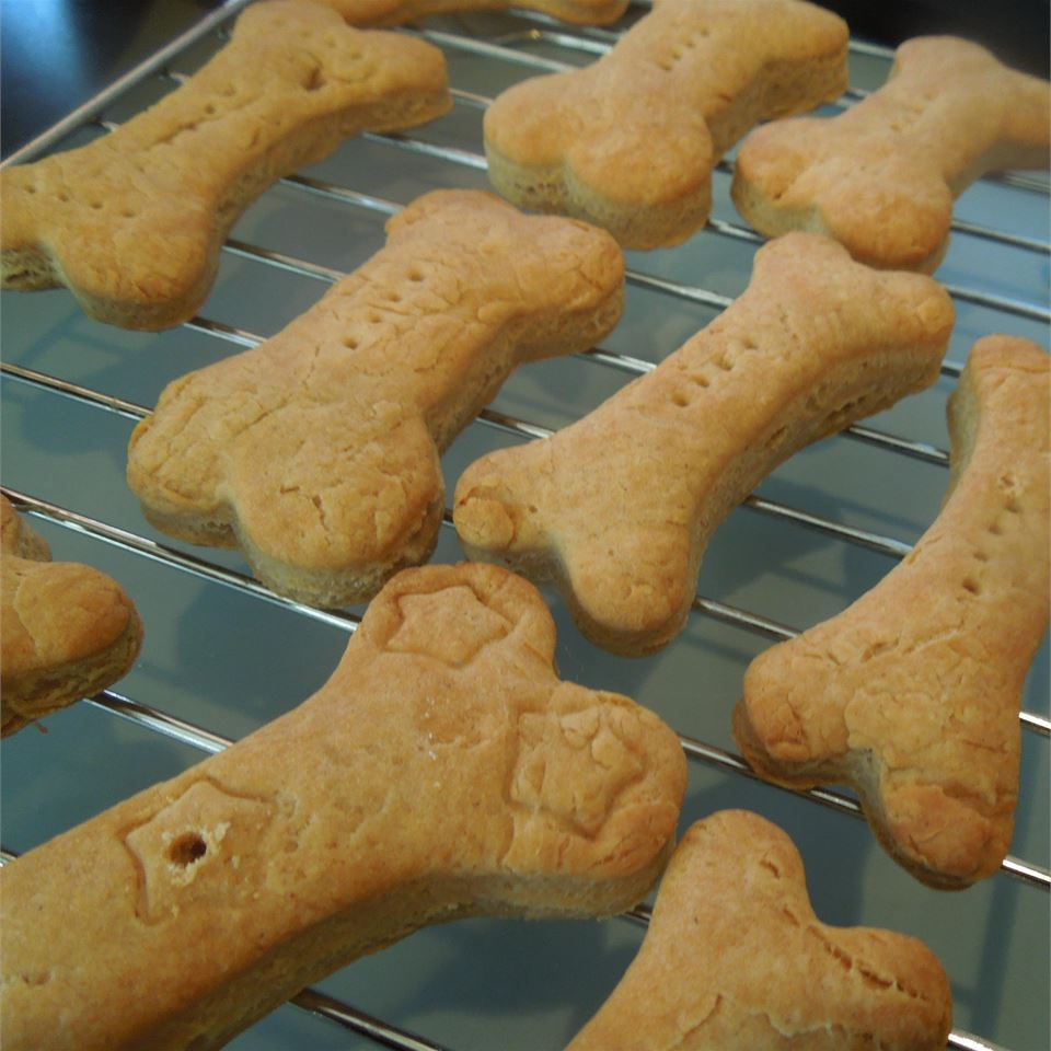 """Four ingredients are all you need for these simple dog treats. The dough holds its shape, making it great for using cute cookie cutters on. Tami says, """"Use doggie type cookie cutters, like bones or fire hydrants."""""""