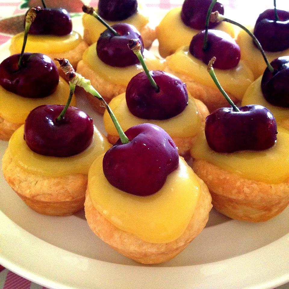 "These gorgeous treats would be perfect for a tea party. Homemade lemon curd is spooned into homemade tart shells and chilled before serving. You can top them with slivered almonds, whipped cream, or fruit before serving. ""These are little bites of lemon heaven,"" says SMICHELITCH. ""I did not change a thing to this recipe and my family LOVED them."""
