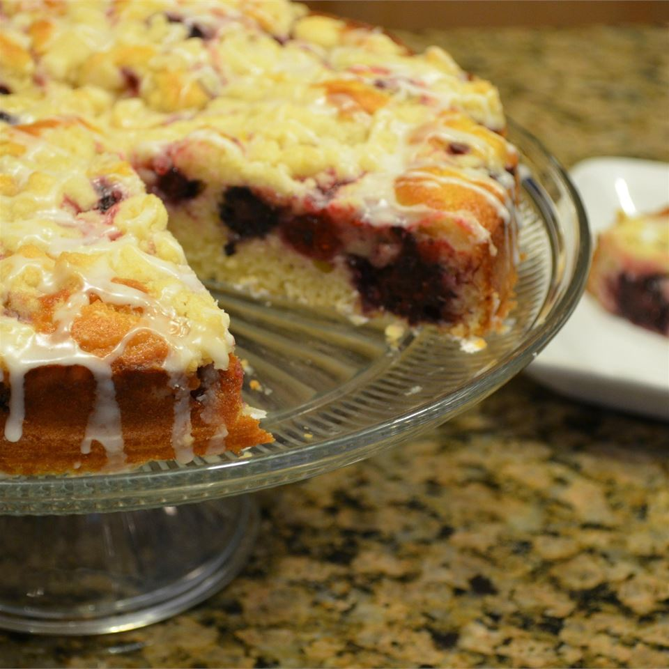 Raspberries and almonds add flair to this coffee cake drizzled with a powdered sugar based glaze. Reduced fat yogurt and only two tablespoons of butter make this cake significantly lower in fat and calories than most other coffee cakes.