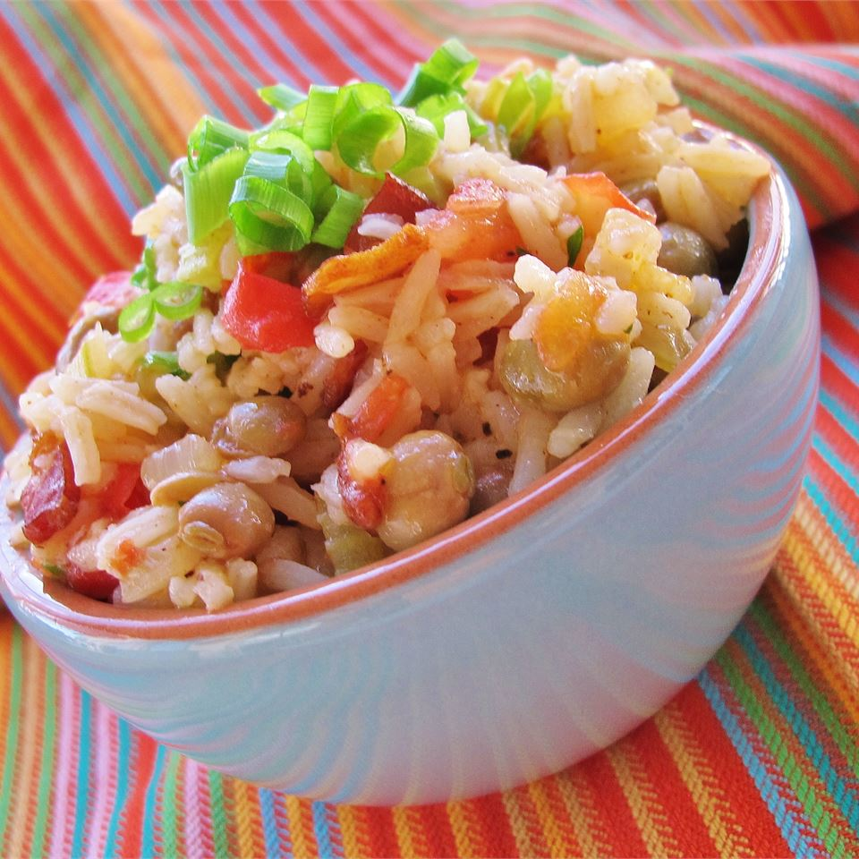 "Caribbean-inspired beans and rice! ""Peas and rice, often served under a tropical sun,"" says DANIELLE2877. ""You may have had it last while sitting on soft white sand, and looking at a clear blue sea. Goes excellently with other traditional Caribbean fare, such as chicken curry or souse."""