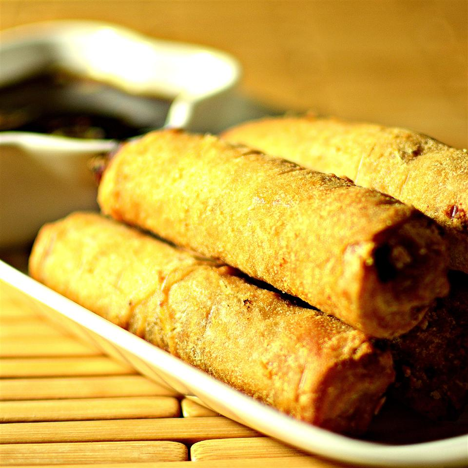 This meat-free lumpia recipe is packed full of vegetables: carrots, French-cut green beans, celery, bamboo shoots, water chestnuts, jicama, and bean sprouts. You can easily add strips of fried tofu if you want to add plant-based protein. The recipe says you can use egg roll wrappers, but for best results, you really should use lumpia wrappers.