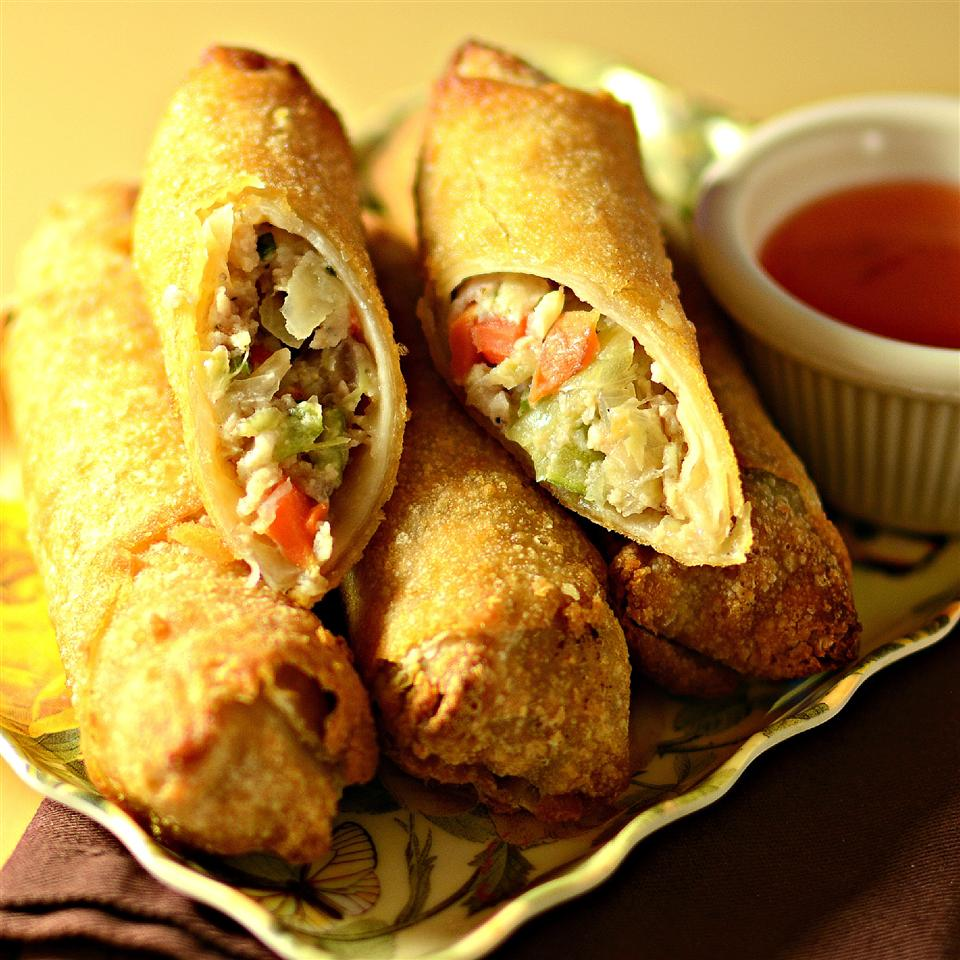 Unlike with other recipes, you don't have to cook the filling ahead of time for these beef and pork lumpia — but just be sure to keep the rolls thin enough so the filling will cook thoroughly when you fry them. This recipe makes about 100 lumpia.