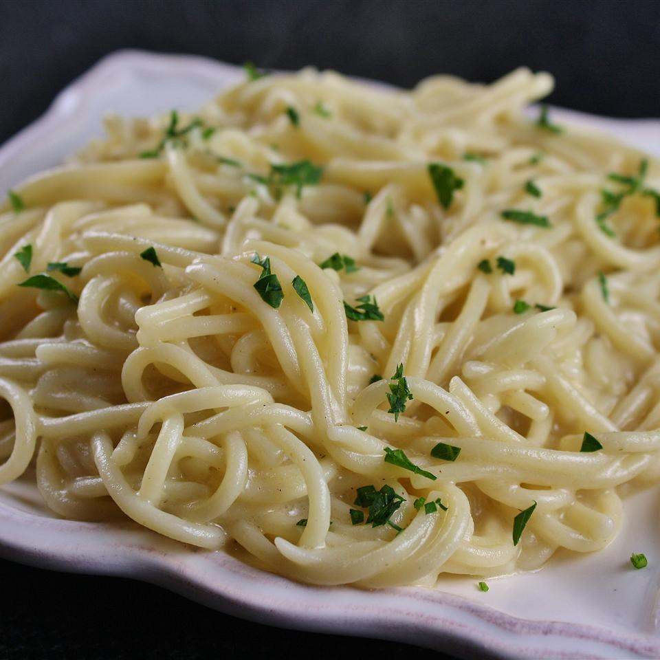 """A quick, simple pasta tossed with butter, parsley, and Parmesan cheese,"" says VAMPYRELADY. ""A wonderful recipe to make when you don't feel like making a trip to the grocery store. I used what I had on hand and it worked like a charm! Add summer vine-ripened tomatoes for an extra dash of flavor!"""