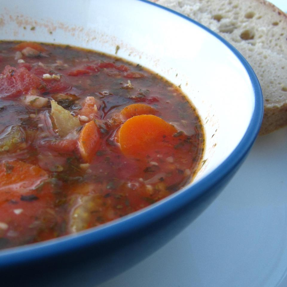 """Fasolatha is the national Greek dish,"" says CORWYNN DARKHOLME. It's a piquant tomato-based bean soup with oregano, thyme, and fresh parsley. ""It has nourished generations. Olive oil is one of the vital ingredients of this delicious dish so do not economize with it."""