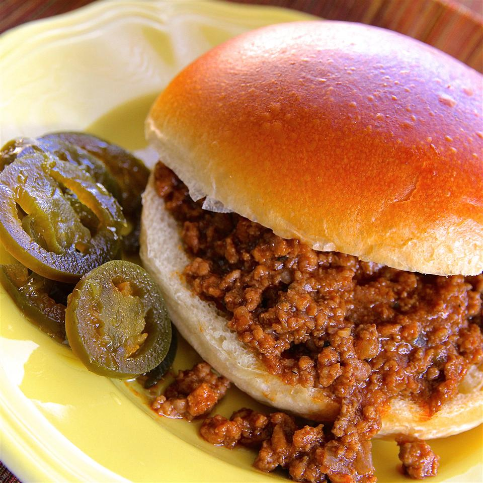 "Here's a spicy spin on an American classic. Mexican-style hot tomato sauce punches up the flavor of sloppy joes. ""I grew up a Manwich kid, thinking they were the same as sloppy joes,"" says Me Recipes. ""I was dead wrong. This is the real deal. Messy, yummy, kid-friendly perfection especially on a cold night."""