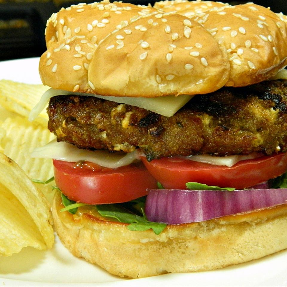 "Ready in 20 minutes. ""An awesome turkey burger with garlic, pesto, feta cheese, and seasoned salt,"" says ELADOUSA. ""Even my husband liked it, and he typically will only eat traditional burgers!"""