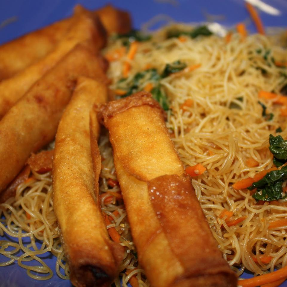 """This is my grandma's lumpia and pancit that she has been making since before the family moved to the U.S. when my dad was a child,"" says LANIBIRD. ""She serves her lumpia with a garlic and vinegar dipping sauce. It's very pungent, but oh so tasty. You can make a large batch of the lumpia and freeze it, so you can fry up some when ever you crave it! Spring roll wrappers are the best to use, they are thinner and lighter than egg roll wrappers."""