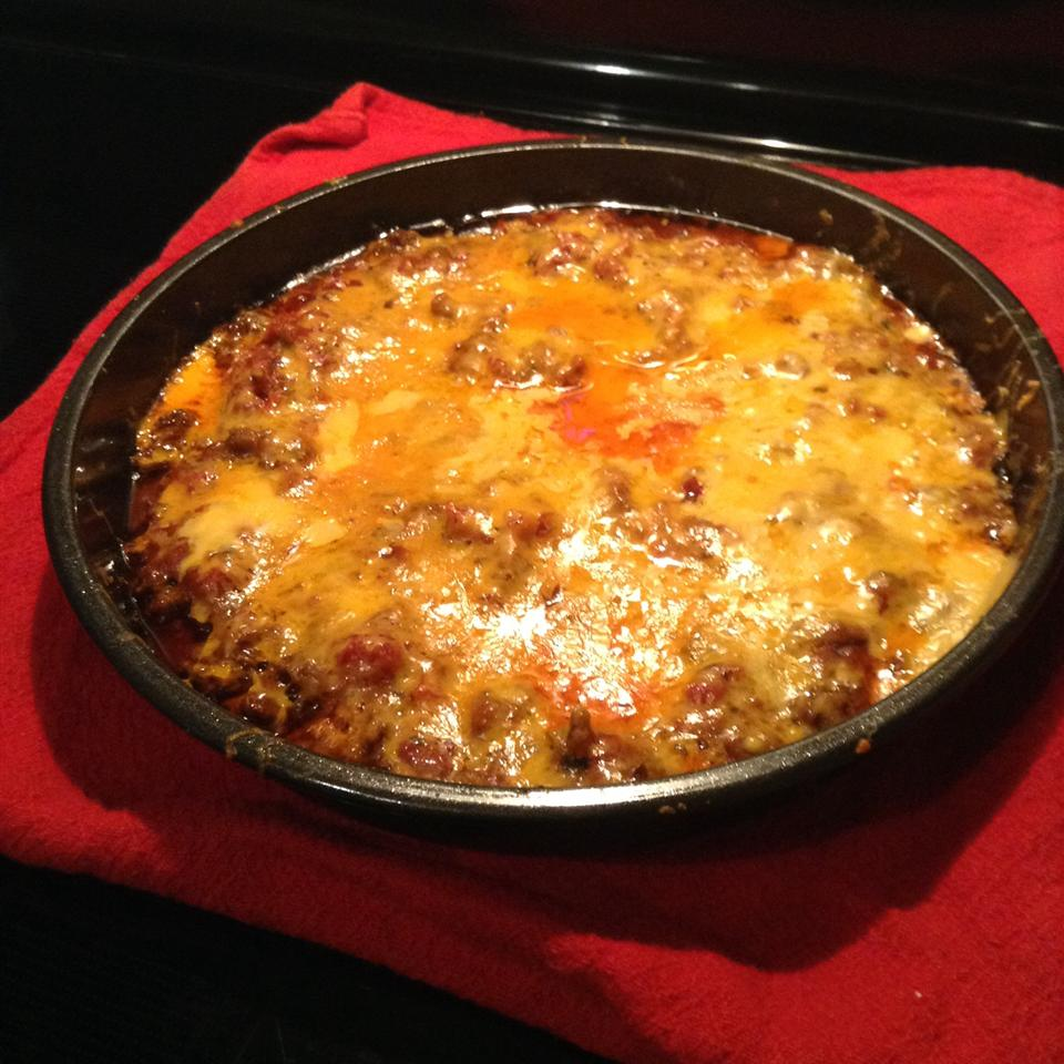 Layer seasoned browned ground beef in a casserole with canned refried beans and salsa, top with shredded Monterey Jack cheese, and bake for 20 minutes.