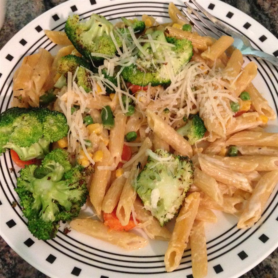 "Broccoli, carrots, and peas get cozy with penne pasta that's been simmered in broth for extra flavor. ""This is fantastic!"" raves MAZZO. ""I have made this twice now and love how flavorful it is without having it coated in red sauce. The Parmesan puts this dish over the top."""