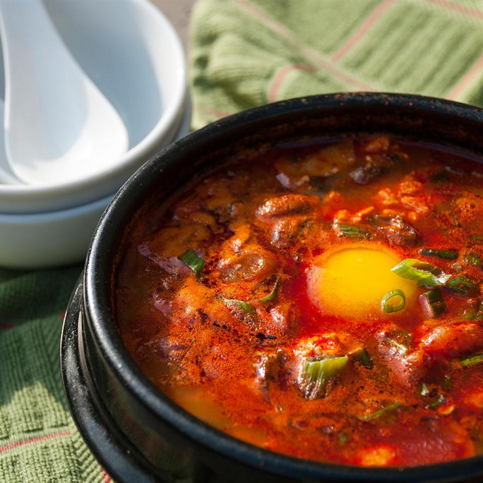 """This is is an easy and authentic version of Korean tofu stew,"" says susi EM. ""I used to eat this every day at a very popular restaurant. It's very versatile. Small pieces of meat or seafood can be added. It's thick and great in the winter and can be made very mild or very spicy."""