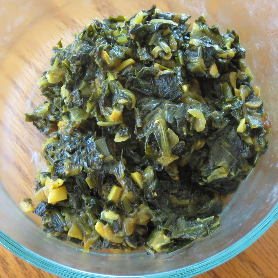 Dandelion Greens with a Kick Lady at the Stove