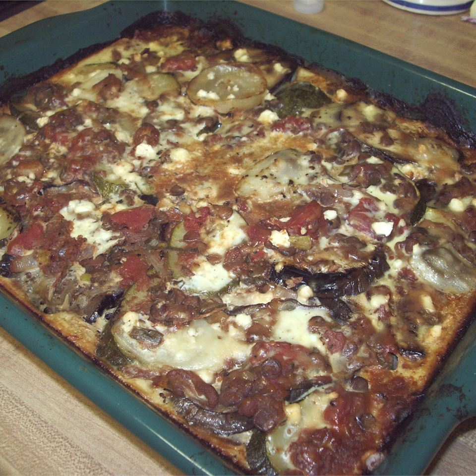 """Slices of eggplant, zucchini, potatoes and onion are layered with tomatoes and lentils and baked with a bechamel white sauce. """"Spectacular!"""" raves MeatballMatt. """"Very good, easy to make. Everybody loved this, and it was filling. Will make again."""""""