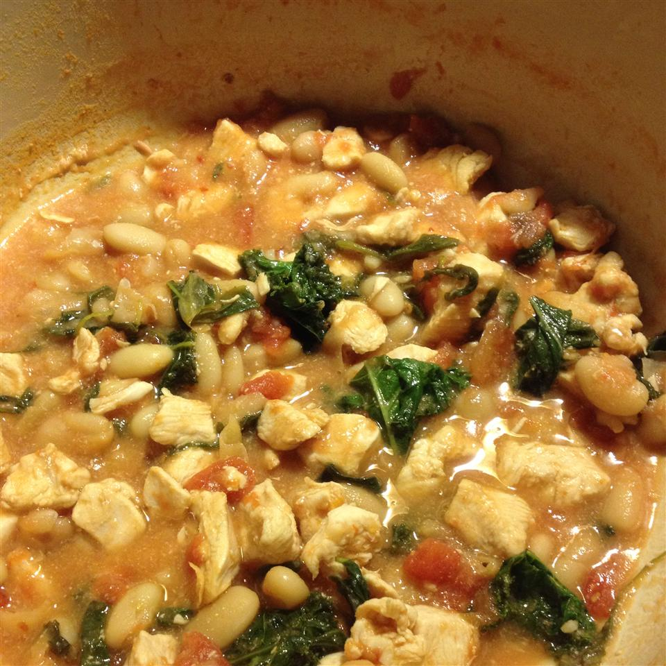"""A hearty tomato and white wine-based bean stew for cold winter nights,"" says amanda1432. ""For lovers of the peppery arugula plant!"" Crystal says, ""This is a very delicious and easy recipe to make. I used the slow cooker and added the arugula, basil, and cooked pasta at the end. Dinner was ready when I got home from work."""