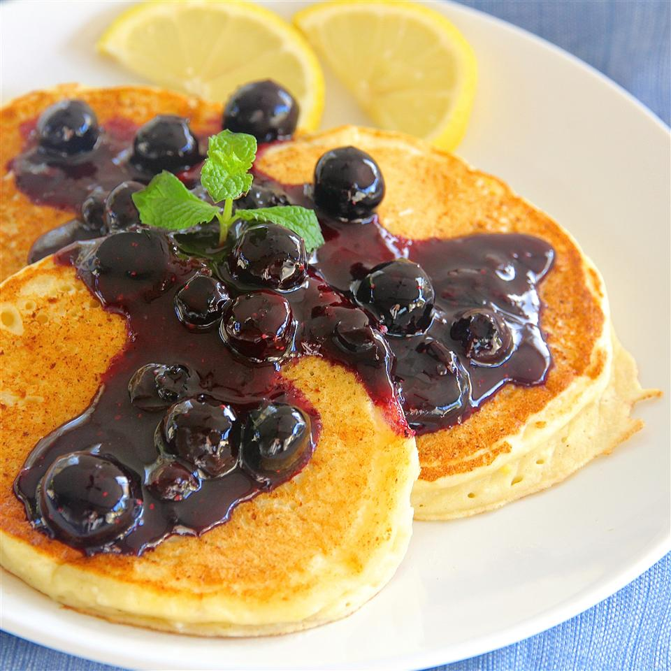 """She's not just any mom, and these aren't just any pancakes. They're bright and lemony pancakes made fluffy with ricotta cheese and topped with a homemade blueberry sauce. Mom deserves no less.                                   """"Fantastic! I made these exactly as written so I could rate it fairly. I loved the blueberry and lemon flavors together. The pancakes were light and airy. I read all the reviews first, so I didn't just throw it all in a bowl. I think keeping them warm in 150 degree oven finished them off inside."""" —djspugs"""
