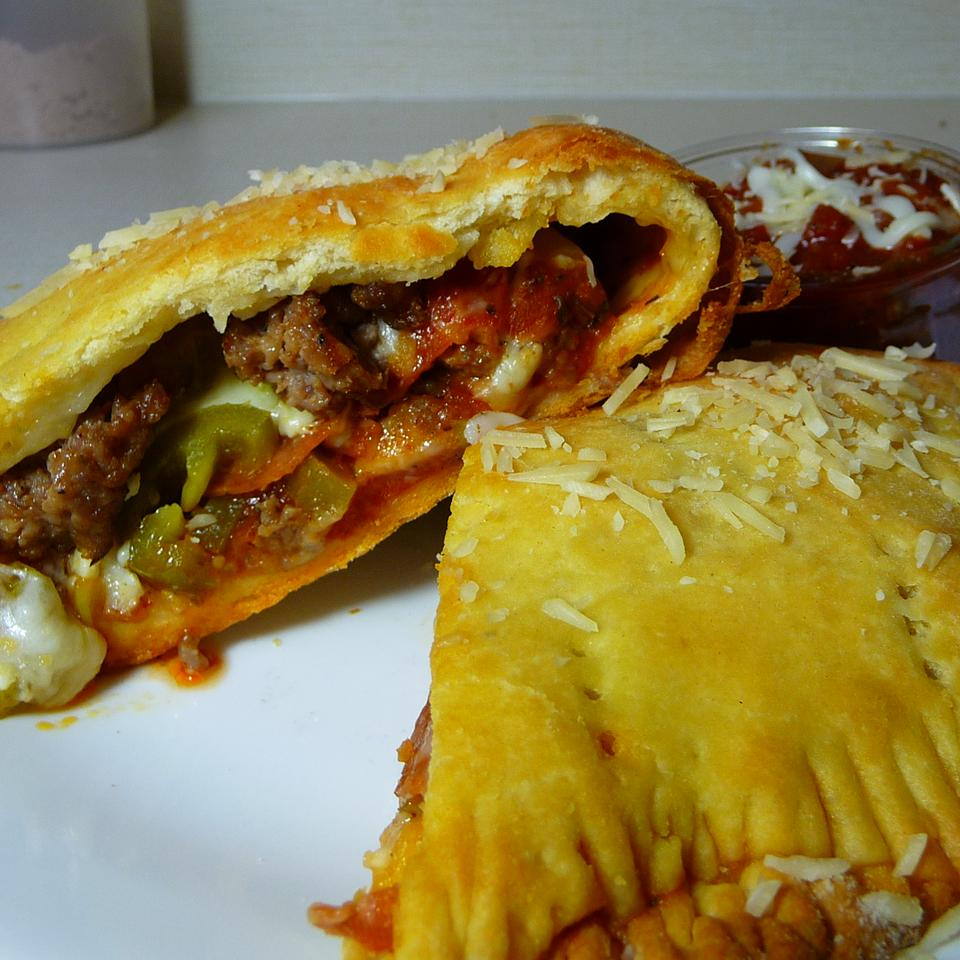 Quick Sausage and Bell Pepper Calzones Kraig
