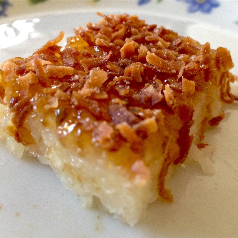 """This popular baked dessert made from soaked glutinous rice, coconut milk, and sugar has a dense, creamy, chewy texture. Reviewer Beya says, """"This recipe came out tasting better than the biko I buy at the Filipino store. Follow these steps to make it authentic: I used only 2 cups of rice (makes plenty) & soaked it for a couple hours in 3 cups water. Make sure you use glutinous rice! Cooked it with half the can of coconut milk and soaking water. Cook it just like rice till it gets soft and mushy. For topping:instead of preserves,I used macapuno strings (4 tbsp) or more. When you remove the biko from oven, it will be slightly soft and a little liquidy. But, when it cools it sets. The finishing touch is brown coconut jam spread on top. I will never buy biko again!"""""""