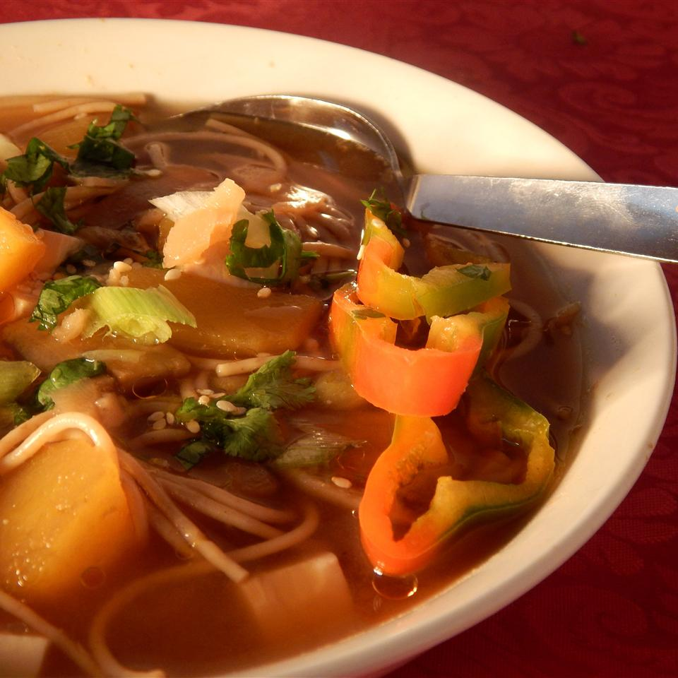 """Cubes of pumpkin and tofu combine with buckwheat noodles garnished with green onion, sesame seeds, and pickled ginger. """"A delicious Japanese-style miso soup suitable for vegetarians and vegans,"""" says IDIOTEQUE."""
