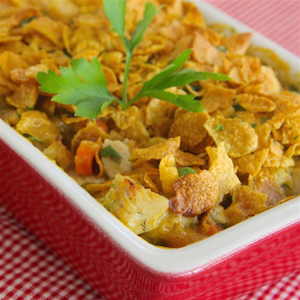 "If you're craving comfort, you'll love this dish that recipe creator Donna Henderson Hopgood  says combines the flavors of chicken pot pie and buttermilk fried chicken, and is ""The ultimate in yummy casseroles!"" It's a great way to use freezer staples such as frozen peas and chicken breasts, and the parsley and dill add freshness."