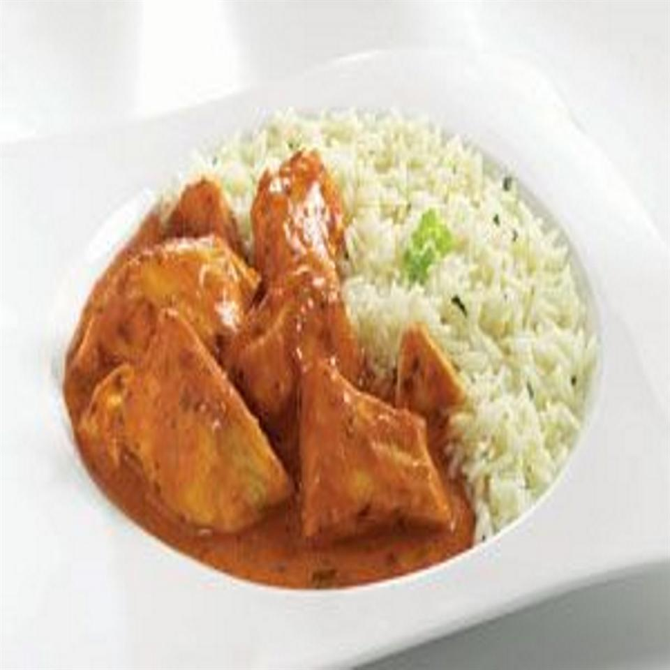 """This traditional Indian dish is creamy and full of flavor and should be served over some kind of carb (rice, potatoes, naan) to absorb and dissimulate the spice,"""" says DOSTANDEN. """"It can be easily done in a vegetarian version by substituting the chicken with potatoes, broccoli, spinach, and/or paneer. I garnish it with cilantro leaves and grated cheese."""""""