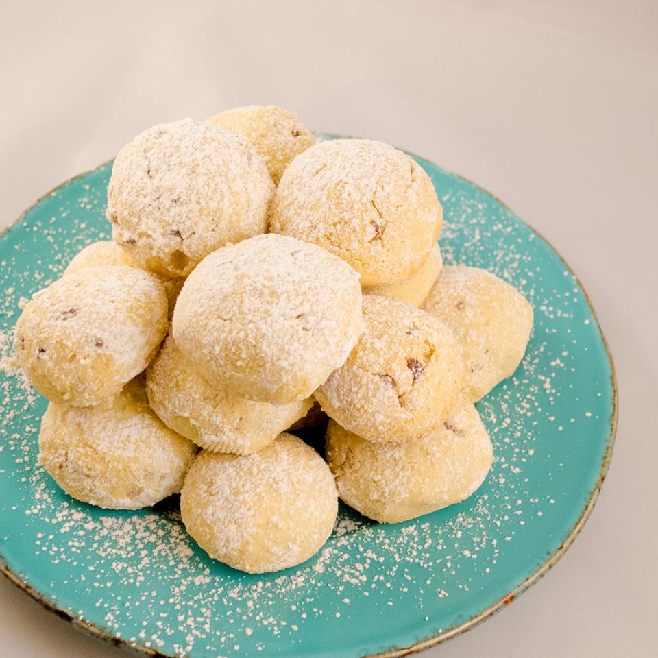Dusted with confectioners' sugar and shaped like snowballs, these cookies would be perfect for a cold Christmas.