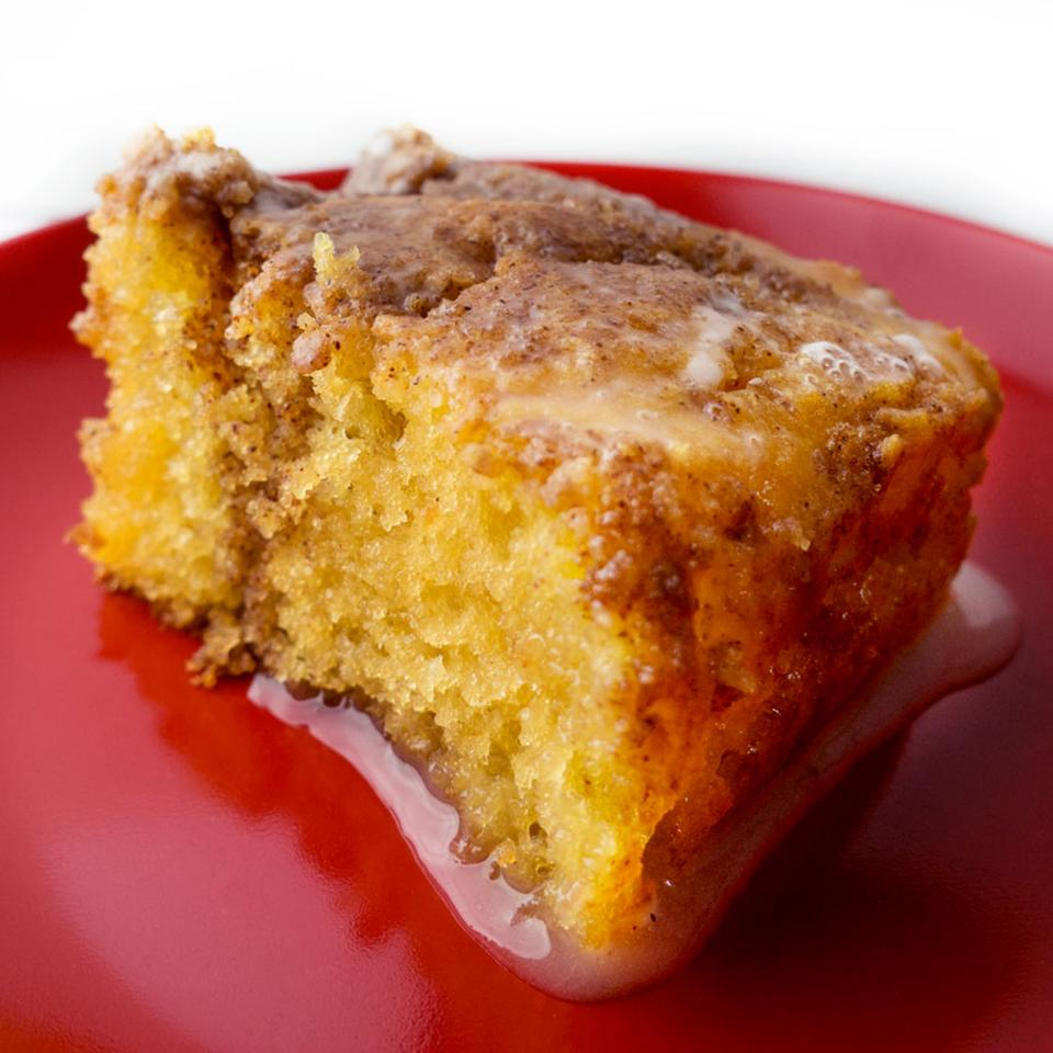 This deliciously easy cinnamon cake is poked all over with a knife and the holes are filled with a runny icing. Allow the cake to cool and absorb all the sweet icing before serving. Be warned... don't expect this cake to last long!