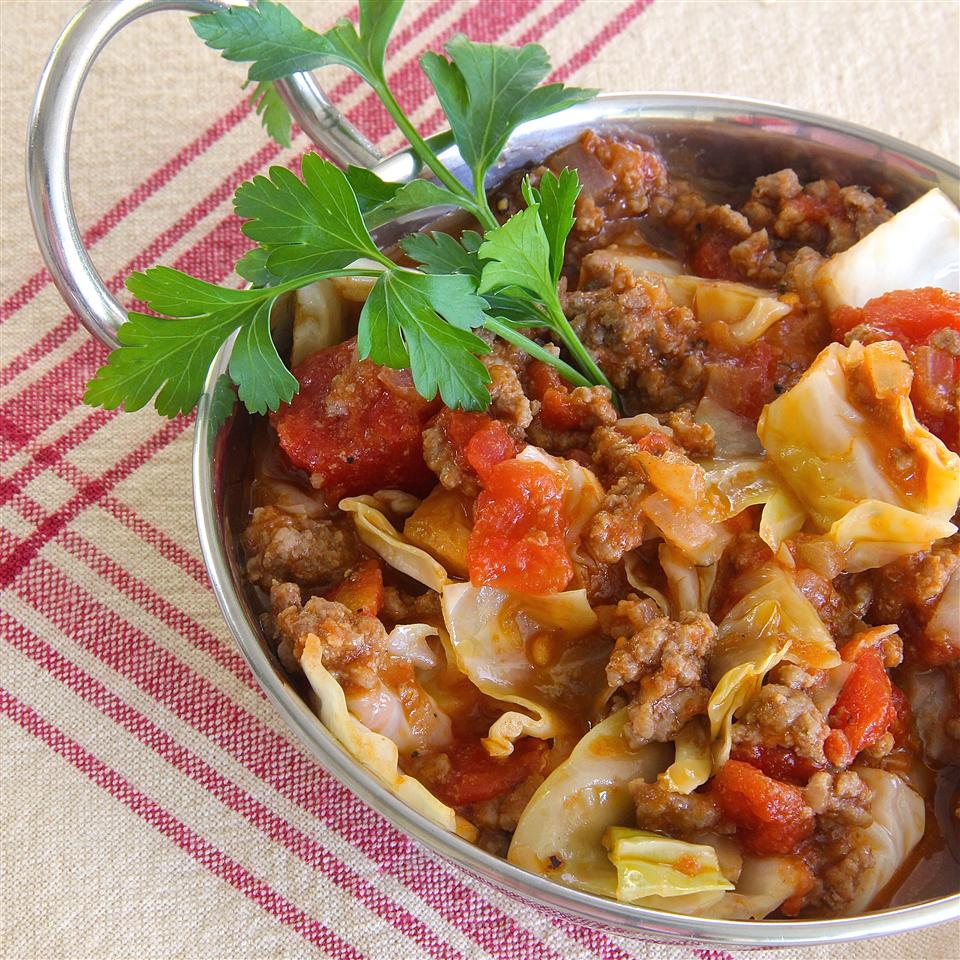 """Ready in 45 Minutes.Ground beef, cabbage, and tomatoes combine with red pepper flakes, garlic, and Italian seasoning. """"A satisfying meal, nothing fancy, but just good, old-fashioned, home-cooked food,"""" sayslutzflcat."""