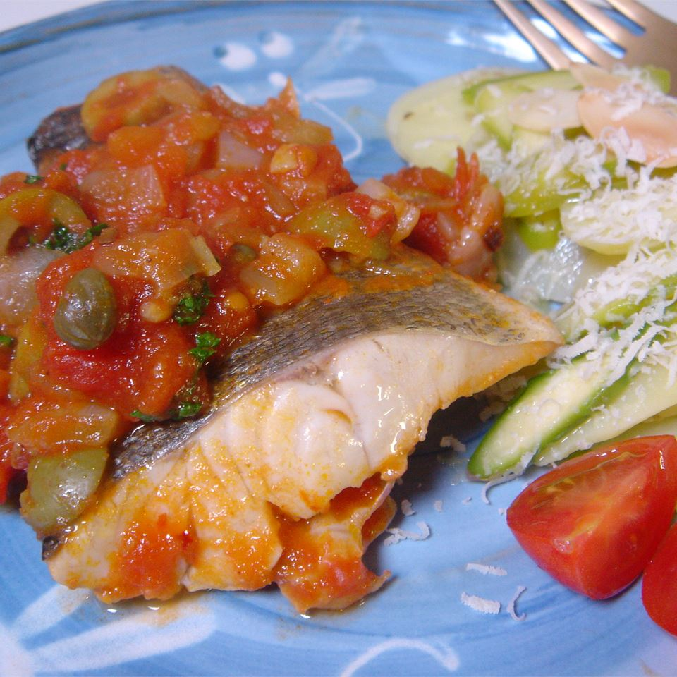 "Sea bass fillets simmer in a green olive, caper, and garlic-laced tomato sauce in this speedy recipe. Reviewer Nskiddo21 found it flawless: ""I can't stress how perfect it is...I made NO changes to this one."""