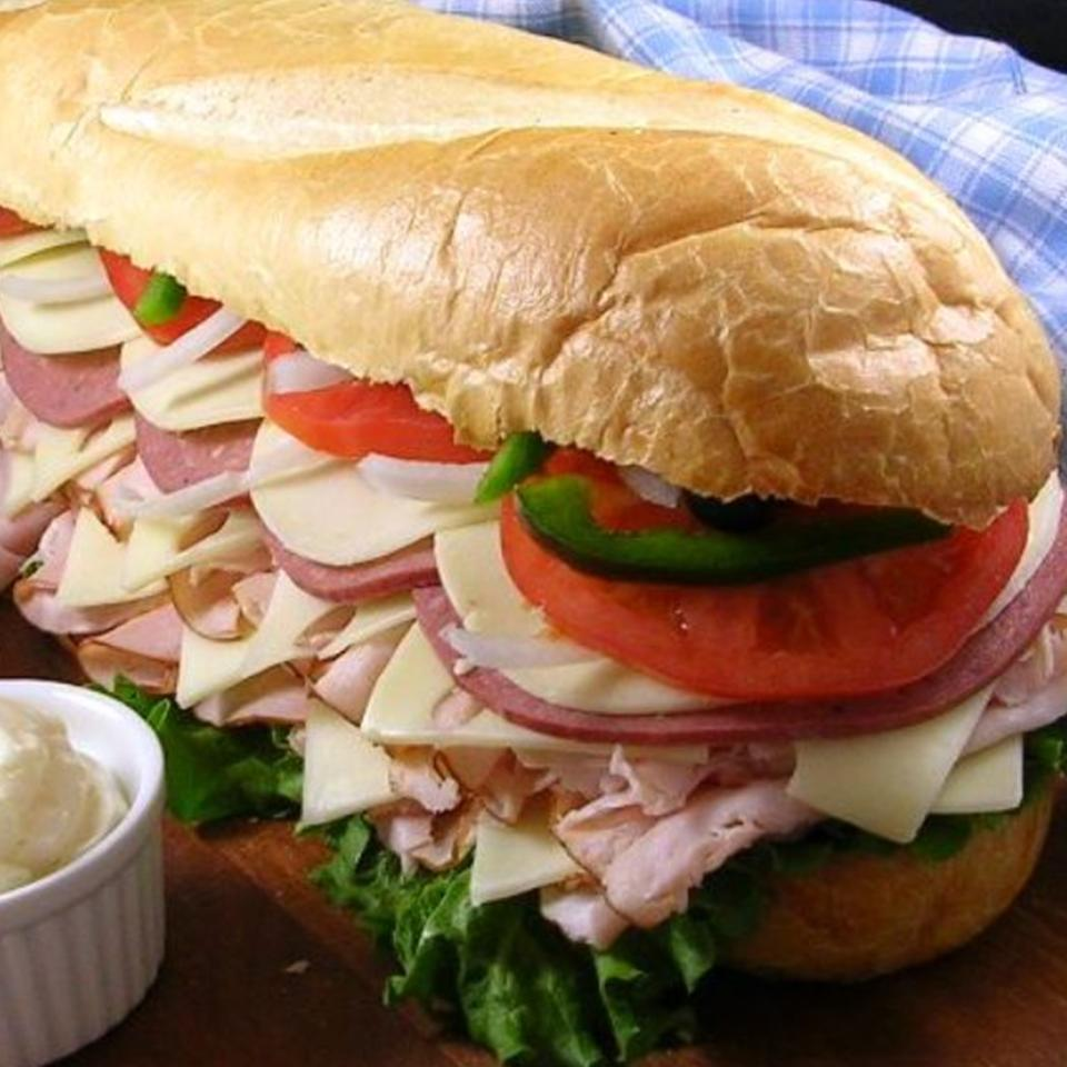 "Primary care physicians would remind you that cold cuts should be a sometimes thing. It's fair to say, then, that six pounds of cheese and cold cuts on a single sub sandwich are an every four years kinda thing. For best results, share with a friend or eight. ""The ultimate Super Bowl party sub,"" says Bradley. ""Serve with chips and a cold dill pickle. And remember to lift with your legs, not your back. """