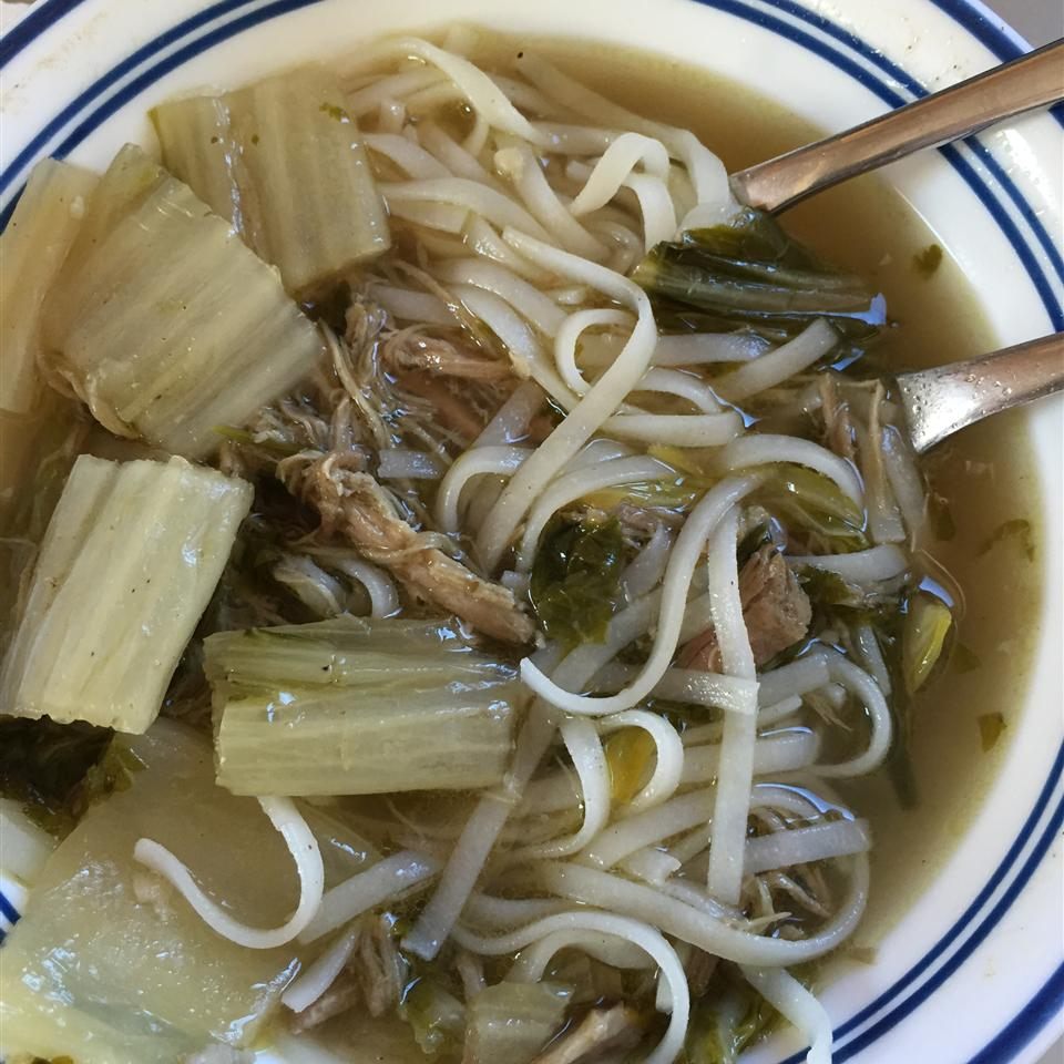 "In the slow cooker, you'll combine bone-in pork shoulder roast with chicken broth, water, bouillon cubes, seasoned salt, Cajun seasoning, onion powder, and butter. Shred the tender pork off the bone, and then cook bok choy in the savory broth. ""My spin on 'yaka mein soup' with pork and bok choy,"" says dugpark. ""It's a family favorite. Serve with condiments including crushed red pepper flakes, Parmesan cheese, and lime wedges."""