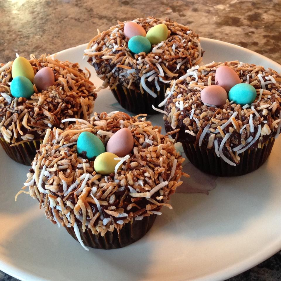 "Frost the cupcakes with chocolate frosting, cover with toasted coconut, perch egg-shaped candies on top. ""Easy to put together, inexpensive, and so cute,"" says Dee."