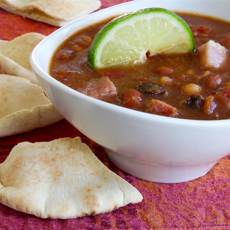 """Peanut butter, mango chutney, ham, and lime juice in chili? """"Yes, and it's delicious!"""" says Janice Elder. """"This incredibly quick and easy chili is a perfect antidote to fancy holiday meals and works equally well using chopped leftover turkey."""""""